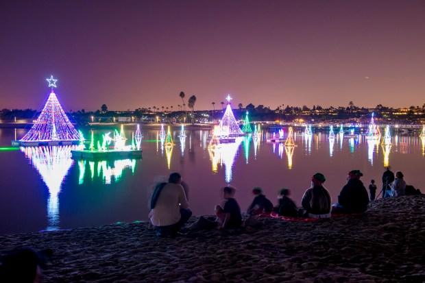 People gather on the beach at the Newport Dunes Waterfront Resort to watch the 26th Annual Lighting of the Bay on Friday in Newport Beach on Friday, November 25, 2016. (Photo by Leonard Ortiz, Orange County Register/SCNG)