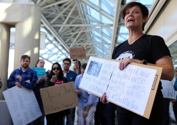 Democratic congressional candidate Julia Peacock, right, addresses protesters upset with President Donald Trump's travel ban at Ontario International Airport in this January file photo.