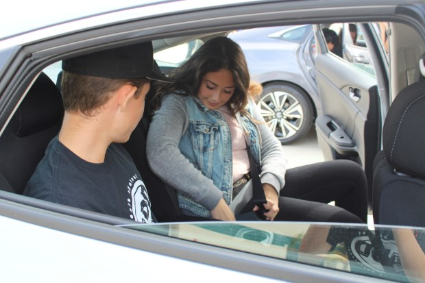 "Chaparral High School students Jennifer Chaidez and Jacob Schmidt participate in SADD National's ""Rock the Belt"" campaign by competing in a ""click it or ticket"" seat belt relay race on Oct. 19, 2017. (Photo courtesy of Katherine Phung)"
