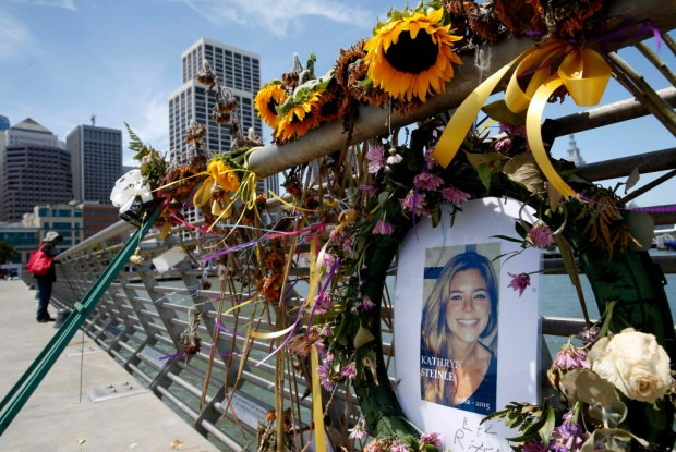 Flowers and a portrait of Kate Steinle sit at a memorial site on Pier 14 in San Francisco on July 17, 2015. (Paul Chinn /San Francisco Chronicle via AP, File)