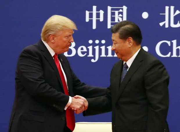 President Donald Trump reportedly asked Chinese President Xi Jinping, right, to help resolve the shoplifting case involving three UCLA basketball players. (Andrew Harnik/The Associated Press)