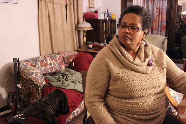 Francesca Valentine, a sickle cell mother and advocate, sits in her home in Lisle, Ill. (Jenny Gold/Kaiser Health News)