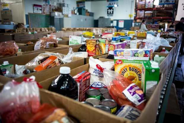 Boxes of food are prepared for distribution at the MEND food bank in Pacoima. MEND will give out over 200 boxes of food for the holidays beginning Wednesday. ( Photo by David Crane/Los Angeles News Group )