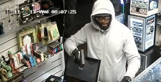 The LAPD is looking for this gunman who robbed a convenience store in the Mid-Wilshire area on Nov. 15, 2017. (Image from surveillance video courtesy of the LAPD)