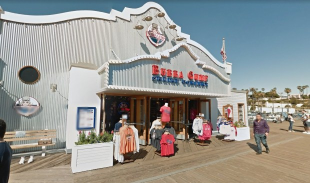 A 22-year-old motorist was booked on suspicion of attempted murder after his car struck a person before crashing into the Bubba Gump Shrimp Company restaurant on the Santa Monica Pier. (Image from Google Street View)