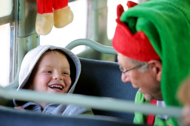 Brycen Campbell, a 5-year-old Elsinore resident, laughs Sunday, Dec. 3, as he enjoys a visit from Jingles the elf, played by Ken Schwartz, on the Train to Santa's Workshop at Orange Empire Railway Museum in Perris. Photo by Terry Pierson, The Press-Enterprise/SCNG