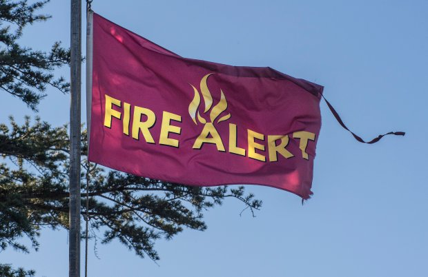 Earlier this month a fire alert flag flies in the wind at the headquarters of Irvine Regional Park in Orange as Santa Ana winds continued to blow. (Photo by Mark Rightmire, Orange County Register/SCNG file)