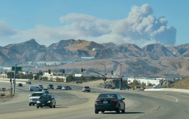 Smoke billows in the distance, looking west, as viewed from Newhall Ranch Road in Valencia on Wednesday, December 6th, 2017. (Photo by Dan Watson / SCNG)