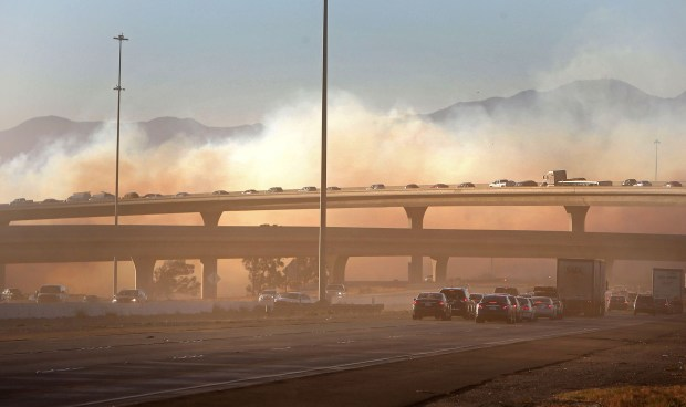 The 15 Freeway was shut down near the 60 Freeway as smoke from a fire blows across the lanes Thursday, Dec. 7, 2017. (Staff photo by Stan Lim, The Press-Enterprise/SCNG)