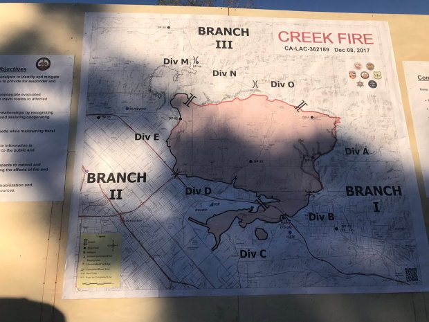 This photo show the containment lines that have and haven't been created around the Creek fire as of Friday morning. (Photo by Wes Woods)