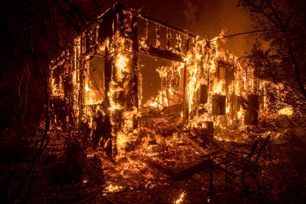 Flames consume a home as a wildfire burns in Ojai, Calif., on Thursday, Dec. 7, 2017. (AP Photo/Noah Berger)Jet Propulsion Laboratory climatologist Bill Patzert noted that over the past half century, development steadily encroached into the regionÕs three main Santa Ana wind corridors: The Santa Clarita River Valley from the city of Santa Clarita to Ventura, scene of the current Thomas fire; the Cajon Pass along Interstate 15 north of San Bernardino and Banning Pass between Palm Springs and Moreno Valley.