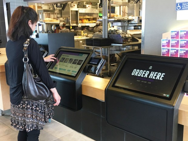 Taco Bell is testing self-serve ordering stations at a store in Irvine near The District shopping center. The Irvine chain said Thursday that it plans to step up kiosks in 2018. (Nancy Luna, Orange County Register/SCNG)