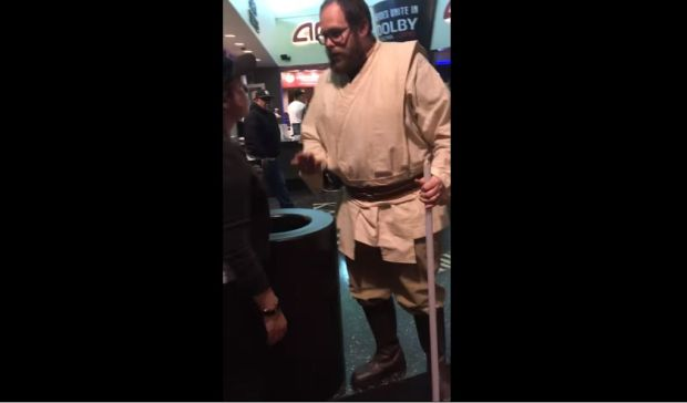 "A costumed theater worker appears to sympathize with an angry moviegoer late Thursday, Dec. 14, 2017, after ""Star Wars: The Last Jedi"" began screening without sound at the AMC Burbank 16 Theatres. (Image from YouTube video)"