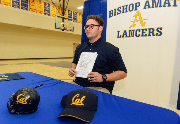 Defensive tackle Aaron Maldonado signs his letter of intent with University of California, Berkely during a ceremony at Bishop Amat High School in La Puente on Wednesday Dec. 20, 2017. (Photo by Keith Durflinger, San Gabriel Valley Tribune/SCNG)