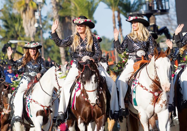 The Norco Cowgirls Rodeo Drill Team ride their horses along Colorado Boulevard during the 125th Tournament of Roses Parade in Pasadena, Calif., Wednesday, Jan. 1, 2014. (AP Photo/Ringo H.W. Chiu) ORG XMIT: CARC121