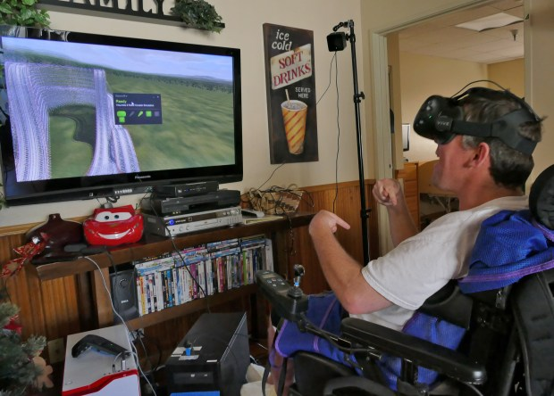 Chris Betancourt, a 20-year-old facing terminal cancer, started virtual reality video game organization Gamers Gift to share his love of gaming with disabled people so they may have new experiences. Wednesday they visited a group home in Lomita to share some joy with residents. Daniel Webster is thrilled as he rides virtual roller coaster.Photo By Robert Casillas,Daily Breeze/ SCNG