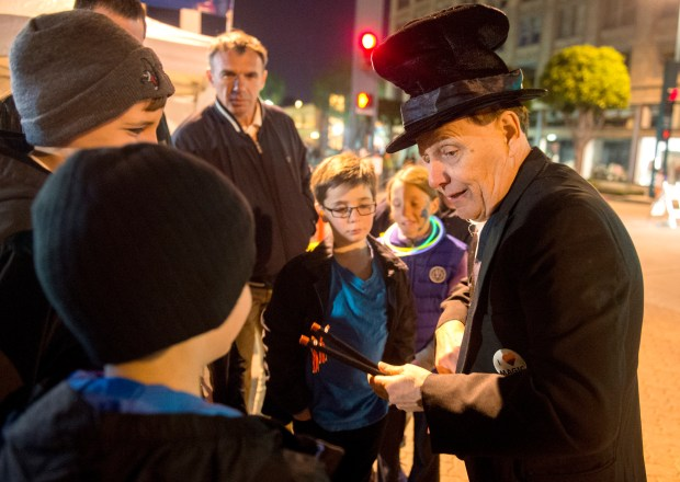 A magician performs magic to the kids at the New Year's Eve celebration in downtown Fullerton. (File photo by Kyusong Gong, Orange County Register/SCNG)///ADDITIONAL INFORMATION: first.night-12/31/14- KYUSUNG GONG, STAFF PHOTOGRAPHER – The City of Fullerton will host its 23nd First Night Fullerton, an alcohol free New Year's Eve celebration of the arts, on Wednesday from 7 p.m. to midnight.