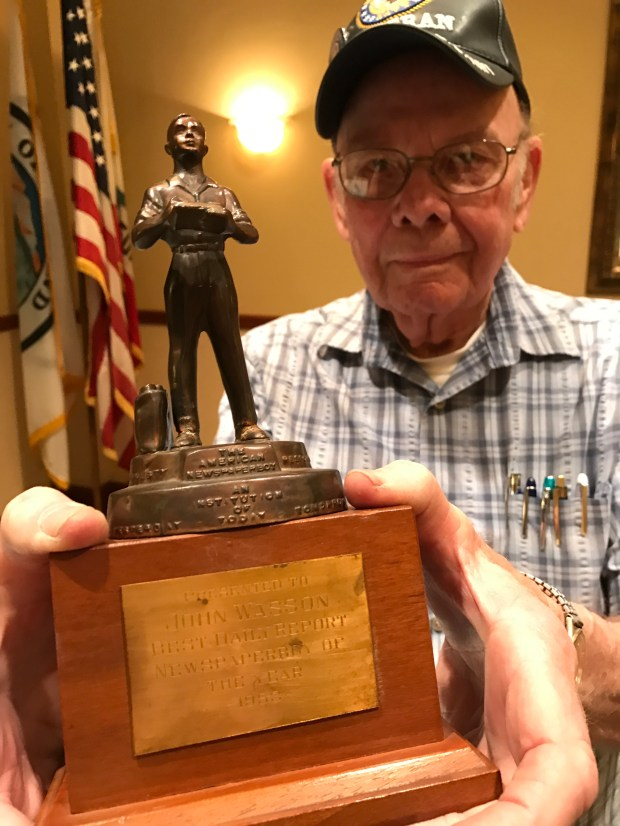 John Wasson of Upland still has his trophy for being the Ontario Daily Report's best paperboy in 1953. (Photo by David Allen)