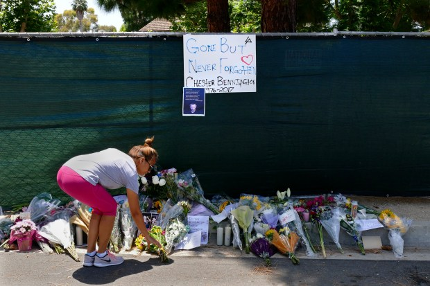 A curbside memorial at the Palos Verdes Estates home of Chester Bennington, lead singer of band Linkin Park, who committed suicide Thursday morning. 2800 block of Via Victoria. Fans brought flowers and left messages for the singer. Photo by Brad Graverson/SCNG/07-20-17