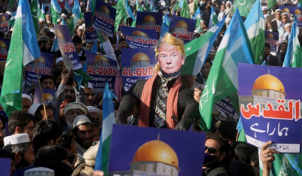 Supporters of Jamaat-e-Islami take part in an anti-American rally to condemn U.S. President Donald Trump for declaring Jerusalem as Israel's capital, in Peshawar, Pakistan, Friday, Dec. 22, 2017. (AP Photo/Mohammad Sajjad)