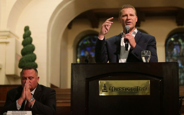 GOP Leader Chad Mayes speaks to the Riverside County Republican Party as Chairman Jonathan Ingram, left listens with the packed house at The Mission Inn Hotel and Spa in Riverside, CA. August 17, 2017. (TERRY PIERSON,THE PRESS-ENTERPRISE/SCNG)
