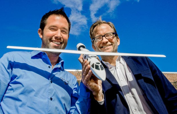 Kevin Noertker, Co-Founder & CEO, of Ampere, left, and Matt Petersen, President & CEO of LACI with airplane model designed Tuesday, November 7, 2017. Ampaire, a Los Angeles-based developer of all-electric zero-emission airplanes, is in development of its first zero emission passenger and cargo airplane. The company aims to initially launch a retrofit of a common turboprop followed by pilot tests of all-electric jets incorporating the latest technologies.(Photo by Walt Mancini/Pasadena Star-News/SCNG)