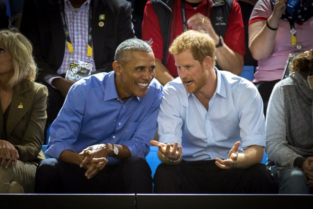 In this Sept. 29, 2017 photo, former U.S. President Barack Obama, center left, and Britain's Prince Harry watch wheelchair basketball at the Invictus Games in Toronto. (Chris Donovan/The Canadian Press via AP, File)
