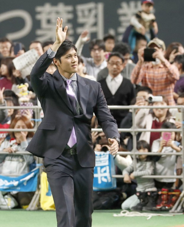 Shohei Ohtani waves to fans during a news conference in Sapporo, Japan on Dec. 25. He bid farewell to fans of his former Japanese club Nippon Ham Fighters as he sets off to join his new team, the Angels. (Masanori Takei/Kyodo News via AP)