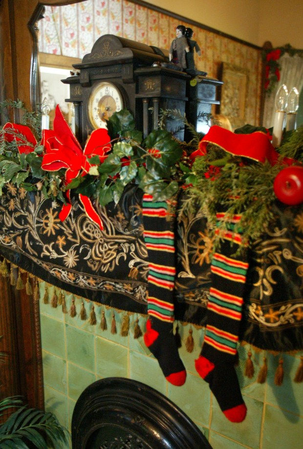 fntvictorian5.p0102.jeh.jpgshootdate: 122702 Victorian Christmas fireplace in Dr. Clark's house at the Fullerton Arboretum. The tour attracted a steady stream of visitors during the holidays. The home was originally on Lemon Street in Fullerton and was moved to the arboretum. The house was built in 1884 and became100 years-old in 1994. It has an Eastlake architecture of ball and stick.(cq) Photo: Jack E. Hancock/The Orange County Register