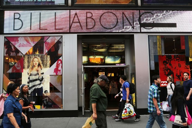 People walk by a Billabong store in Manhattan on Sept. 18, 2012. (Photo by Spencer Platt/Getty Images)