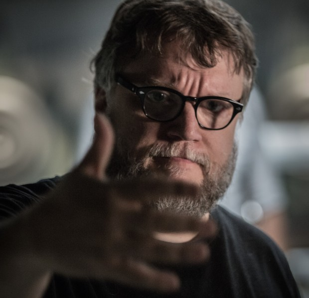 "This image released by Fox Searchlight Pictures shows director Guillermo del Toro on the set of ""The Shape of Water."" Del Toro was nominated for a Golden Globe for best director, Monday, Dec. 11, 2017, for the film. The 75th Golden Globe Awards will be held on Sunday, Jan. 7, 2018 on NBC. (Kerry Hayes/Fox Searchlight Pictures via AP)"