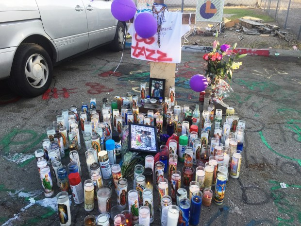 A memorial was set up outside the Short Stop Food Store at the corner of East Nocta Street and Allyn Avenue in Ontario, where a 16-year-old boy was fatally stabbed during a fight Friday night. (Photo by Stephen Ramirez, Inland Valley Daily Bulletin/SCNG)
