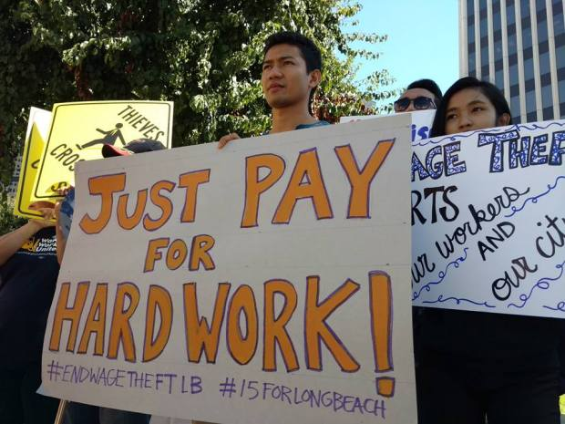 Protests over low wages, such as this one in Long Beach in 2015 pressured local officials to raise minimum pay.