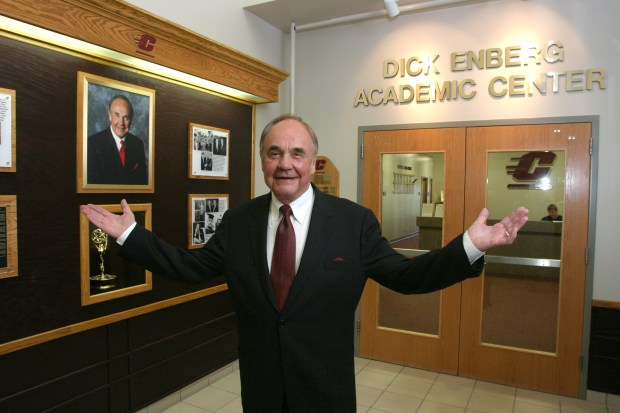 "In this Oct. 12, 2007, file photo provided by Central Michigan University, 1957 Central Michigan graduate Dick Enberg poses at the student-athlete academic center named in his honor in CMU's Indoor Athletic Complex in Mount Pleasant, Mich. Enberg could only find two words to express his pleasure at learning he will be honored in May 2009 with the second Vin Scully Lifetime Achievement Award in Sports Broadcasting: ""Oh, My."" (AP Photo/Central Michigan University, Robert Barclay)"