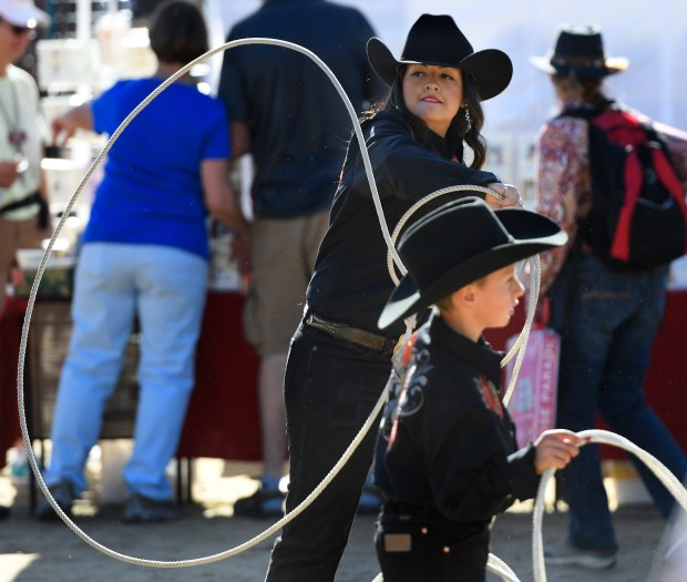 Maggie Lopez,16, and Jaden White,9, are members of the Broken Horn Ropers. They were practicing their loops at Equestfest, held at the Los Angeles Equestrian Center. The event showcased many of the equestrian units that will participate in the Rose Parade on New Year's Day. Burbank, CA 12/29/2017 (Photo by John McCoy, Los Angeles Daily News/SCNG)
