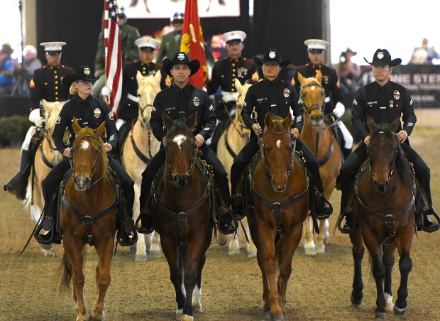 Members of the LAPD Metropolitan Division Mounted Platoon ride out in front of the Marine Corps. Mounted Color Guard at Equestfest, held at the Los Angeles Equestrian Center. The event showcased many of the equestrian units that will participate in the Rose Parade on New Year's Day. Burbank, CA 12/29/2017 (Photo by John McCoy, Los Angeles Daily News/SCNG)