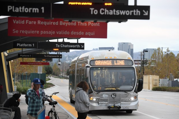 A bus approaches the Sherman Way Station of the Orange Line, Dec. 20, 2017. The Los Angeles City Planning released its proposed plan for the Orange Line Transit Neighborhood Plan. (Photo by Michael Owen Baker)