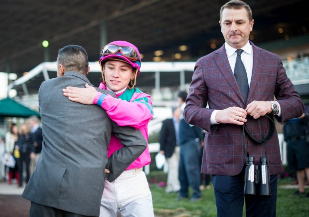 Drayden Van Dyke is congratulated after City of Light's victory in the Malibu Stakes race on Opening Day of Santa Anita Park's winter meet Dec. 26. (Sarah Reingewirtz,/SCNG)