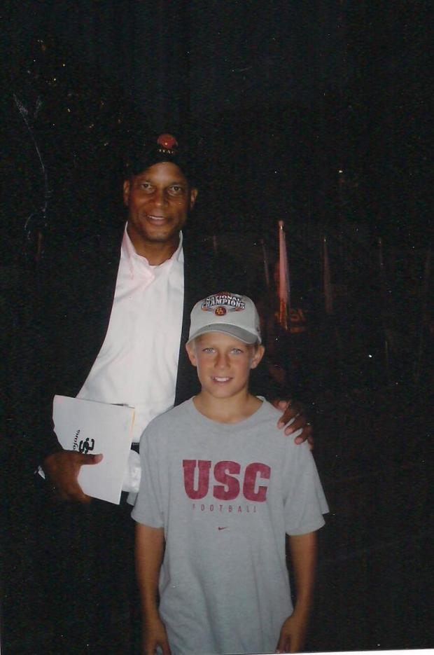 A young Matt Lopes poses with USC football great Ronnie Lott. (Photo courtesy of Lopes family)