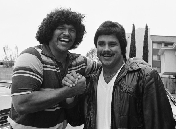 USC offensive linemen Anthony Munoz, left, and Brad Budde congratulate each other on campus on April 29, 1980 after they were selected in the first round of the NFL draft choices. Munoz, a tackle, was picked third by the Cincinnati Bengals and Budde, a guard, was chosen 11th by the Kansas City Chiefs. (Photo by The Associated Press)