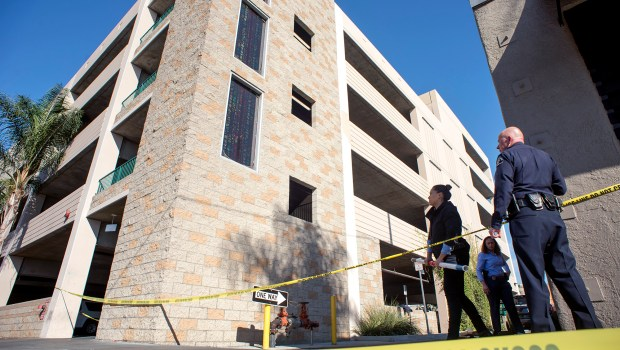Police arrested a man on suspicion of murder after his wife died from falling from a multi-story parking garage at 26 N. First St. in Alhambra, Calif. early Thursday morning Dec. 14, 2017. (Photo by Leo Jarzomb, SGV Tribune/ SCNG)
