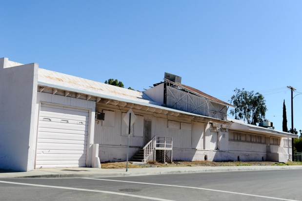 An exterior view of the for-sale MOD (Mutual Orange Distributors) Packinghouse in Redlands, CA on Thursday, Feb. 25, 2016. The city is required to sell properties, including the historic packinghouse, owned by the now-defunct Redevelopment Agency, which was eliminated per Gov. Jerry Brown. (Photo by Rachel Luna/Redlands Daily Facts)