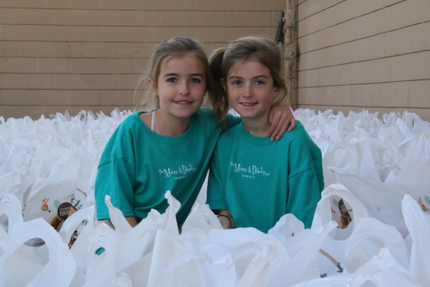 Lyric Moughann and Madison Wochner won $500 from the Kids Adventure Games and donated their winnings to the Inland Empire Community Collaborative to feed 100 families this Christmas in Big Bear Lake. (Photo courtesy of Inland Empire Community Collaborative)