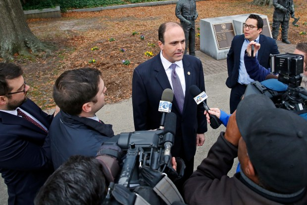 In this Dec. 20, 2017, file photo, Del. David Yancey talks with reporters outside the Newport News, Va., Courthouse. Shelly Simonds, the Democrat in a tied race for a Virginia House seat says she'll ask a court to declare the tie invalid. Simonds' lawyers said Tuesday, Dec. 26, that they'll ask the court to reconsider its ruling after last week's recount. Attorney Ezra Reese said the court violated election law by counting a ballot for Yancey a day after the recount. (Jonathon Gruenke/The Daily Press via AP, File)
