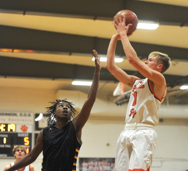 Poly's Tobin Kund takes a shot pressured by North's La Shawn Jackson during the first half of an Inland Valley League boys basketball game at Riverside Poly HS on Tuesday January 16, 2018.