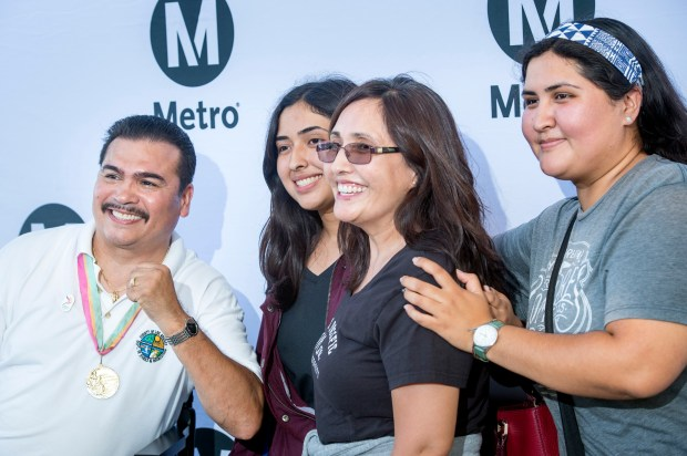 Olympic gold medalist boxer Paul Gonzales poses for a photo with La Puente well-wishers from left: Debora Muñoz, 17, mom Alicia and sister Anna at the Metro El Monte Bus Station August 5, 2016. Metro is sponsoring meet the Olympic gold medalist events at area transit stations over the next 10 days. (Photo by Leo Jarzomb/Pasadena Star-News)