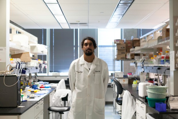 Cliff Kapono, a biochemist heading up the Surfer Biome Project, in the lab at the University of San Diego. (Ariana Drehsler/The New York Times)