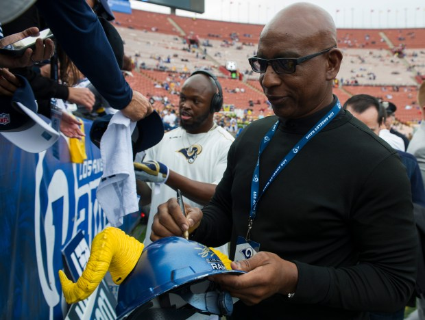 Eric Dickerson signs autographs for fans before the Los Angeles Rams takes on the Atlanta Falcons in a wild card game at the Los Angeles Memorial Coliseum in Los Angeles, Saturday, January 6, 2018. (Photo by Thomas R. Cordova Daily News/SCNG)