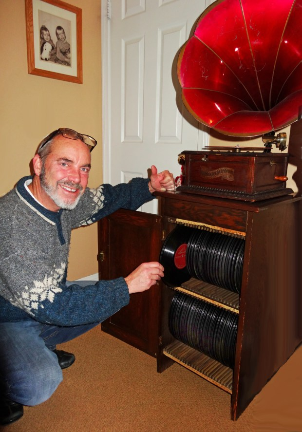 Curtiss Allen Jr. shows how the records are stored in the cabinet for the gramophone he donated to the Museum of Redlands. (Courtesy Photo)