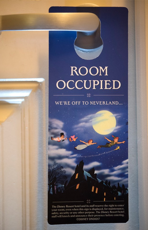 "The Disneyland hotels has new door signs which went into effect Dec. 21, according to resort spokeswoman Suzi Brown. Formerly ""Do not disturb"" signs are replaced with ""Room occupied."" At the bottom in smaller type reads,"" The Disney Resort Hotel and its staff reserve the right to enter your room, even when the sign is displayed, for maintenance, safety, security or any other purpose. "" (Photo by Cindy Yamanaka,, Orange County Register/SCNG)"